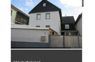 Einfamilienhaus kaufen in 35423 Lich, Einfamilienhaus mit Hofbereich und Garage zu verkaufen