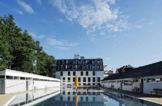 Wohnung kaufen in 79100 Freiburg, Einzigartige Dachgeschosswohnung direkt am Lorettobad mit traumhafter Aussicht